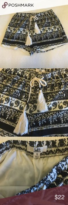 Black White printed shorts These shorts have been worn once. Bought at a boutique and has a really nice feel. They are also have an inside lining and elastic band. Ya Los Angeles Shorts