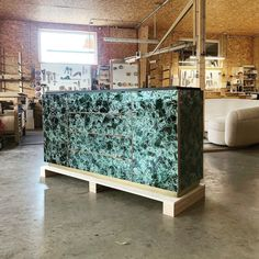 a recently completed Oskar Cabinet in green mica, Designed by Jallu, mica furniture, green mica furniture, green furniture, Jallu Creations 2021, interior design, super yacht interiors, luxe, french craftsmanship, bespoke furniture, custom furniture, made in France, interior design inspiration, design inspiration