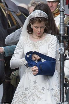 That's better: The Wolf Hall star made sure to remove the protective bandage as she prepared to shoot scenes, recreating the royal wedding of 1947 between Queen Elizabeth II and the Duke of Edinburgh