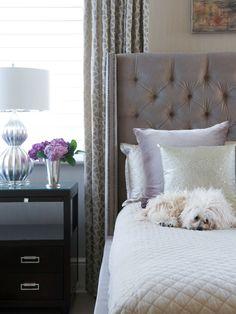 Susan Glick Interiors - bedrooms - gray velvet tufted headboard, lilac velvet pillow, silver shams, silver metallic pillow, black nightstands, silver gourd lamp, white and gray drapes