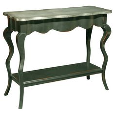 "Scalloped mahogany console table with a bottom display shelf and aluminum-sheeted top.  Product: Console tableConstruction Material: Solid mahogany and aluminumColor: GreenDimensions: 33.75"" H x 41.75"" W x 16"" D"