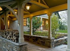 Transition from landscape to shelter: Covered walkway from detached garage to the house.