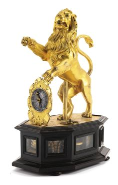 A rare gilt-bronze and ebony automaton table clock, Augsburg, circa 1630 | lot | Sotheby's