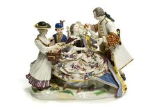 first half 19th century. An elaborate porcelain figural group depicting court life, after the 1738 model by J.J. Kaendler. The queen, in ermine-trimmed robe, receives a gilded heart from a gallant while two attendants look on. On an elongated, flower-strewn base. Underglaze blue crossed swords marks, incised No. 100 and impressed 120; 8.5` high x 9.5` long. See Adams, 2001: 49, No. 113.