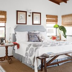 In this Caribbean getaway, homeowner Allison Elebash mixed antiques with classic blue and gray patterns on the headboard, linens, and pillows that hone in on the family's traditional style.
