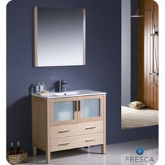 @Overstock.com - The Fresca 36-inch Torino is a sleek free-standing vanity with plenty of storage space. The frosted glass panels of the doors balance out the sleek and modern lines of Torino, making it fit perfectly in either 'Town' or 'Country' decor.http://www.overstock.com/Home-Garden/Fresca-Torino-36-inch-Light-Oak-Modern-Bathroom-Vanity-with-Vessel-Sink/7456518/product.html?CID=214117 $1,079.99