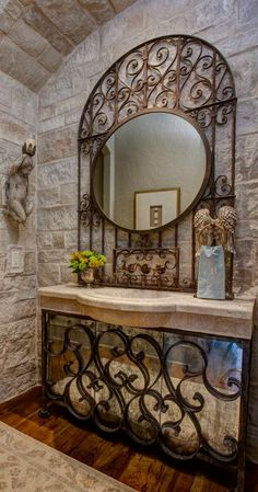 Wrought iron mirror and counter accents... lovely and majestic!  Visit stonecountyironworks.com for more amazing wrought iron designs!