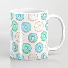 Blue Donuts Mug - illustration design by Hazel Fisher Creations. surface pattern design. Available in 11 and 15 ounce sizes, our premium ceramic coffee mugs feature wrap-around art and large handles for easy gripping. Dishwasher and microwave safe, these cool coffee mugs will be your new favorite way to consume hot or cold beverages.