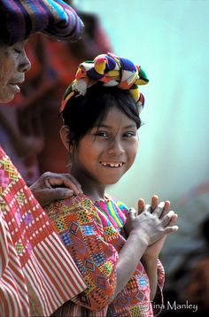 GUATEMALA, GRANADILLO:  Young Mam girl and her grandmother wait to be seen at a medical clinic in the northwestern highlands of Guatemala.