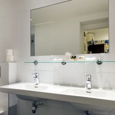 In our standard bathrooms, you will find double sinks. Our hospitality products are very good quality: bubble bath, body lotion, soap, shampoo, cotton swabs. We will also provide slippers, shower caps, sewing sets, and polishing sponges.