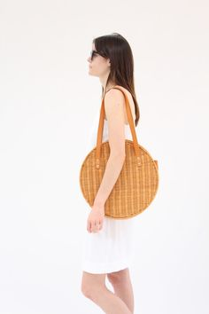 """Large carryall shoulder bag in Italian vegetable-tanned leather and custom wicker hand made in the Philippines. Top opening with two shoulder straps. Handles 16"""" long. Height 15"""" / Width 15"""" / Depth 3"""