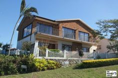 PROPERTY RAMSGATE - RAMSGATE House HIBISCUS COASTThe house consists of 5 large Bedrooms (BIC), 3 Bathrooms (mes), formal lounge upstairs with lots of windows maximizing the breaker sea views and built in bar as well as sliding doors onto the balcony, TV lounge or 2nd lounge downstairs and large kitchen with built in glass top stove and eye level oven.  R 1 995 000