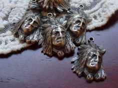 1  Antique silver Indian head vintage style feather head by BuyDiy, $2.98