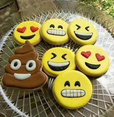 The Pink Cookie Sheet:  emoji decorated cookies.   Poop decorated cookie.