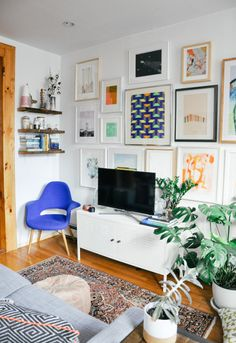art-filled wall & cobalt chair