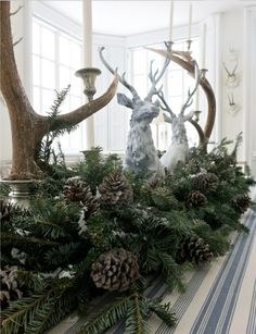 DEVIN~~ for your farm table~~Reindeer figureines with greenery, pinecones and anters - by Carolyne Roehm Christmas Tablescapes, Christmas Mantels, Christmas Wreaths, Christmas Crafts, Christmas Decorations, Holiday Decor, Holiday Tablescape, Woodland Christmas, Christmas Love