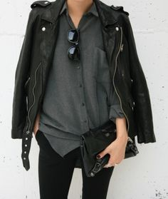 The coolest of cool in a black leather moto jacket.