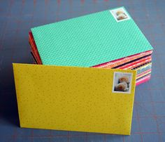 Complete instructions for how to make your own envelopes from a pad of 12x12 scrapbook paper. She made 360 envelopes for only $10. And they are SO cute!
