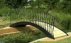 garden bridge over a stream in a Worcestershire garden
