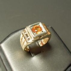 Man's Vintage Art Deco Style 14kt Yellow Gold Orange Sapphire Ring Circa 1960  Containing One Round Cut Genuine Natural Orange Sapphire  weighing approximately 1.28 carats  Ring Size 7 1/2 (can be sized) & weighs 7 grams       Item Number:   WS1307