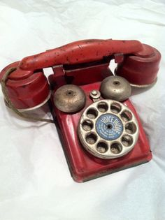 Antique TOY old style telephone by DuDecavintage on Etsy, $53.00. I have this in my collection.