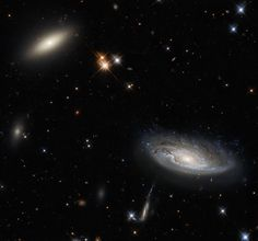 Two enormous galaxies capture your attention in this spectacular image taken with the NASA/ESA Hubble Space Telescope using the Wide Field Camera 3 (WFC3). Carl Sagan, Nasa Juno, Juno Spacecraft, Saturns Moons, Nasa Goddard, Space Probe, Theme Tattoo, Nasa Images, Spiral Galaxy