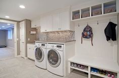 Mud room and laundry combo with a lovely back-splash and cool shelves