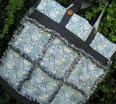 Upcycled Denim Blue Flower Tote Bag. This striking denim blue patchwork tote bag has been made from completely recycled fabrics, combining an old pair of jeans with a Liberty Tana Lawn cotton blouse.