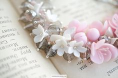 Pink sakura blossom bracelet, Pink flowers and gray glass beads, Sterling silver metal base, Floral gift for women Flowers made of baked polymer clay Size: flowers about 10mm (5/8 inch) Glass beads 8mm (5/8 inch) Not fragile !! its possible to make a pendant or earrings for a set !!