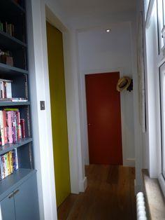 hallway bookshelves Hallway, bookshelves and oversized doors. Hallway, bookshelves and oversized doors. Hallway, bookshelves and overs Co Design, Small Apartments, Bookshelves, Tall Cabinet Storage, Life Hacks, Doors, Furniture, Home Decor, Colour