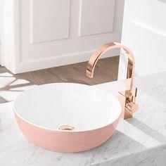 Rose gold facet and pink covered porcelain vessel sink.