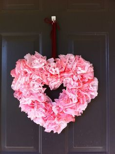 Coffee filter Valentine's Day wreath: -filters dyed with food coloring and hung to dry -glued to a heart-shaped piece of cardboard when dry -hung with red ribbon or yarn