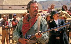 Selleck, who costarred with the late Alan Rickman, used with great accuracy the powerful .45-70 caliber rifle with Semi Buckhorn rear sight. Tom Selleck, Western Film, Western Movies, Great Western, Hero Movie, Movie Stars, Movie Tv, Revolver, Laura San Giacomo