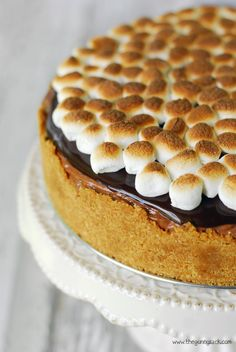 No Bake S'mores Cheesecake Recipe with chocolate, marshmallows and graham crackers.