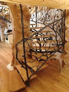 Ručne kované zábradlie Strom-sosna - umelecké dielo v poľovníckej chate - interiérové zábradlie