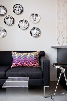 Decorating the wall with plates fetauring Lina Cavalieri print 12 Inspirations That Add Fun Fornasetti Twists to Your Home