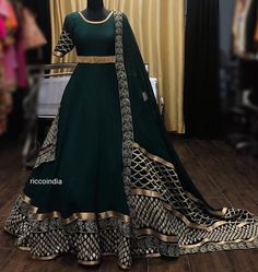 Dark green wedding gown. Click on picture to see Ricco India lehenga price. #Frugal2Fab