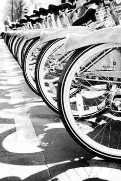 This charming black and white photograph of a row of bicycles has intriguing perspective and is packed with decorative flair. Black N White, Black White Photos, Black And White Photography, Street Photography, Art Photography, France Photography, What A Wonderful World, The Places Youll Go, Paris France