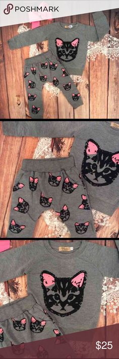 Boutique Toddler Baby Kitty Cat Outfit 3pcs This adorable boutique toddler Kitty cat outfit has banded gray shirt with a large Kitty Cat graphic to the front. The cuffed long pants have a matching Kitty Cat all over print. Pants are harem style (roomy in diaper area) with front pockets.  Cute boutique matching pink bow included. Trendy little outfit!! Catapana Matching Sets
