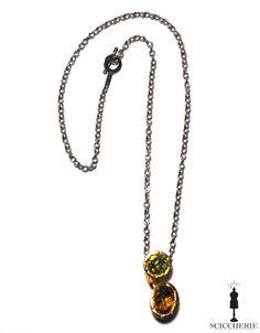 Collana in bronzo acciaio e pietre idrotermali. Pendente con pietre color peridoto e quarzo citrino.