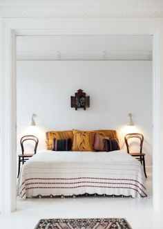 Chairs as bedside tables is a remarkable idea.