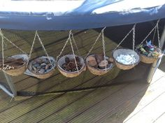 Use hanging baskets to store sandpit toys, trucks, etc. attach to fence and underneath playground.