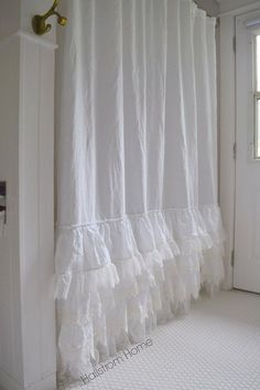 Make your bathroom feel inviting and luxurious with this beautiful handmade shower curtain. White linen and ruffles give this shower curtain a soft shabby chic