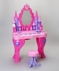 Petite princesses will love making melodies on this real musical vanity! It comes complete with a matching stool and play beauty accessories. The Disney Princesses even magically appear in the mirror.