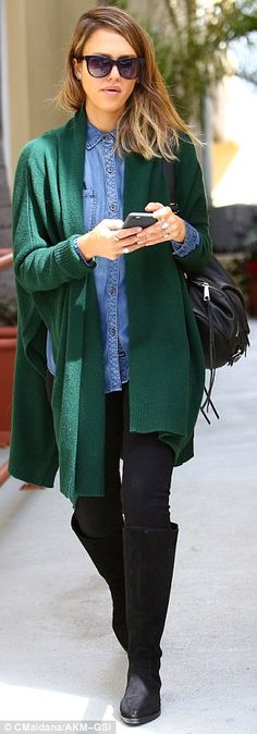 2 March 2015Brightening up the day: The star appeared cosy chic in an evergreen cardigan which she lay...