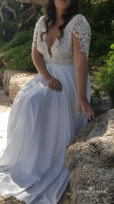 Plus size sexy wedding gown with deep cleavage and long illusion sleeves. Petra. Studio Levana