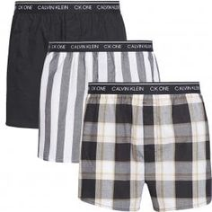 Calvin Klein CK One Slim Fit Woven Boxer 3-Pack, Level Stripe/Black/Field Plaid Calvin KleinCK One Slim Fit Woven Boxer 3-Pack, Level Stripe/Black/Field Plaid Single button fly, classic length, with room for ease and freedom of movement Great value 3-pack in a soft cotton with vivid graphic prints Calvin Klein signature logo stretch waistband This CK Underwear is made from 100% Cotton Calvin Klein Ck One, Calvin Klein Boxers, Ck Underwear, Signature Logo, 90s Fashion, Lounge Wear, Gym Shorts Womens, Plaid, Grey