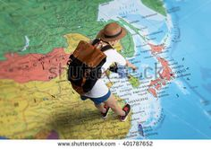 stock-photo-women-traveler-is-planning-a-tour-her-standing-on-the-world-map-she-points-to-japan-401787652.jpg (450×317)