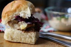 Chicken Tortas Spiced refried beans, smoky chipotle mayo, cumin-scented chicken thighs, and sweet-and-sour red cabbage crunch