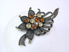 Amber and gold coloured brass and rhinestone brooch. Possibly Czechoslovakian 1960s. Autumn colours. by SellTheOld on Etsy  #trcteam #vogueteam #brooch #brass
